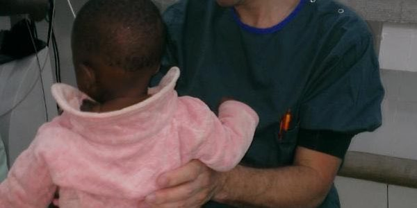 Photo 4: Erik examining a local patient in Serengma