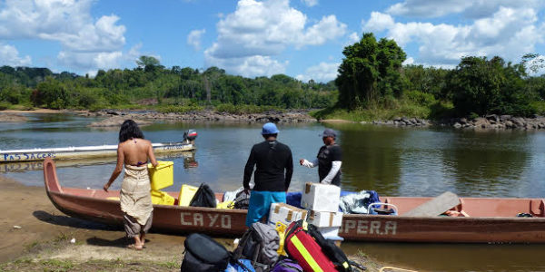 Photo 2: Arriving by boat for consultations during a mission in French Guyana