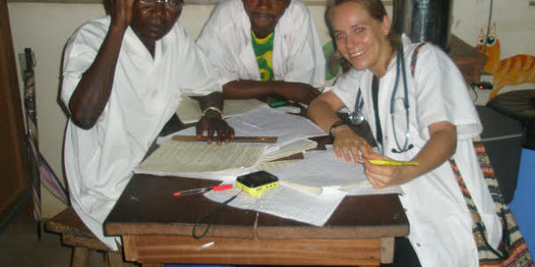 Photo 1: Miranda and local colleagues discuss patients during rounds in the paediatrics department